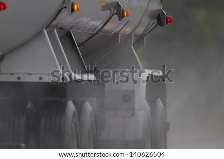 Tanker Truck Driving Through Rain