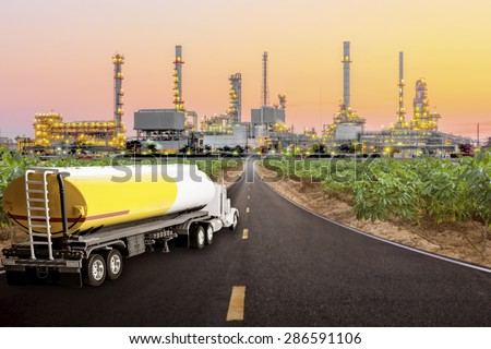 Tanker truck for transport fuel on the highway to petrochemical oil refinery in sunrise