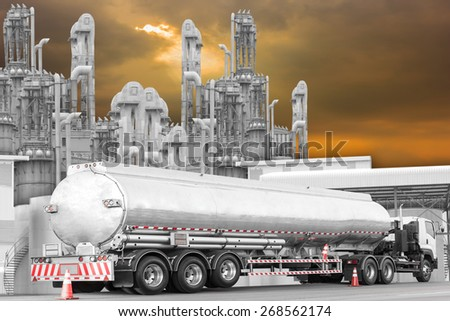 Tanker Truck to transport fuel on the road at refinery oil in sunset