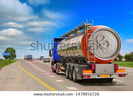Tanker with chrome tanker on the highway. Fuel truck transports beer in a can. Conceptual idea #1478856728