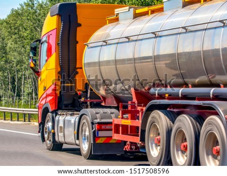 Tanker with chrome tanker on the highway. Working visit #1517508596