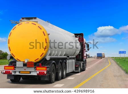 Tanker with chrome tanker on the highway. Working visit #439698916