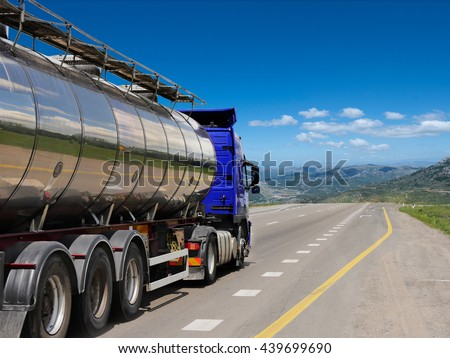 Tanker with chrome tanker on the highway. Working visit