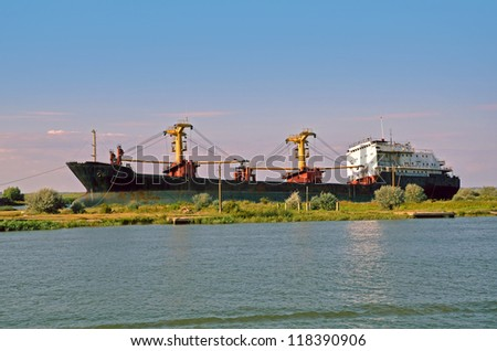 Tanker wreck near the river - stock photo