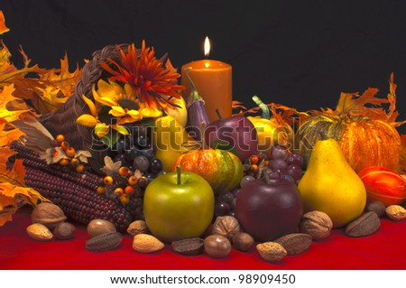 Tanksgiving Cornucopia for of fruits,gourds,nuts,flowers, and a candle
