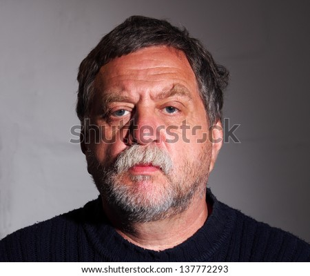 tanned, bearded middle-aged man