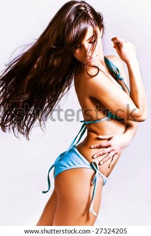 tanned brunette in blue bikini