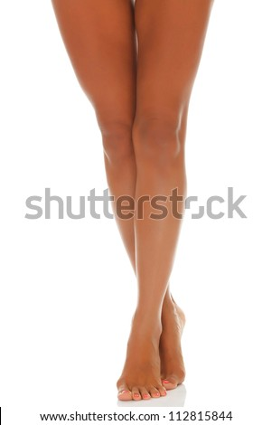 Tanned female legs on white background