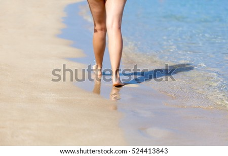 Tanned legs of sexy woman on the sandy beach #524413843