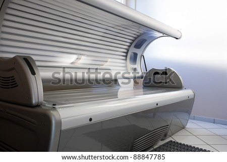 Tanning bed in a salon;  nobody to be seen - stock photo