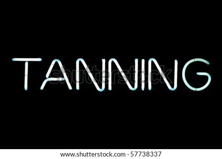 Tanning neon sign isolated on black background