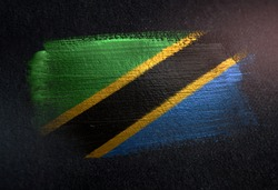 Tanzania Flag Made of Metallic Brush Paint on Grunge Dark Wall
