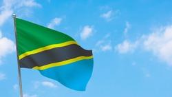 Tanzania flag on pole. Blue sky. National flag of Tanzania