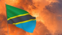 Tanzania flag on pole. Dramatic background. National flag of Tanzania