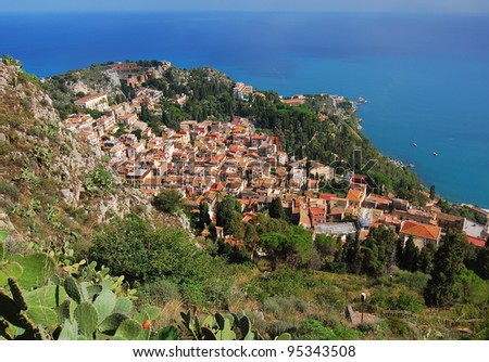 Taormina city view from Saracen castle. Taormina is a small town on the east coast of the island of Sicily, Italy. Taormina is a very popular tourist destination since the 19th century. - stock photo