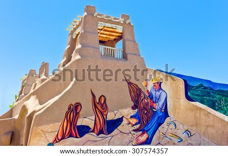 Taos, U.S.A. - May 22 2011:  New Mexico, typical architecture and murals  in the country center