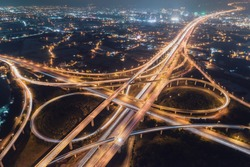 Taoyuan International Airport System Interchange Aerial View at Night - Traffic concept image, panoramic birds eye view use the drone, shot in Taoyuan, Taiwan.