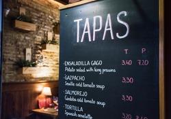 Tapas bar in Spain. Spanish tapas bar in historical center of Seville at night