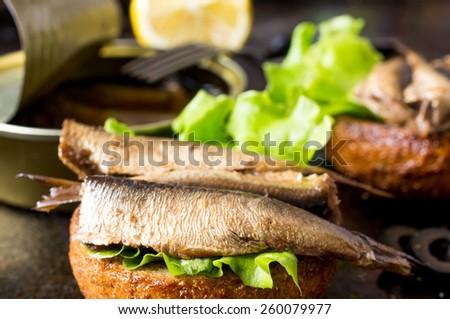Tapas bun burger with smoked sardines or sprats