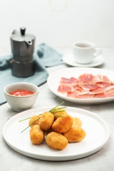 Tapas croquettes, traditional Spanish or French snack usually prepared with mashed potatoes, meat or vegetables