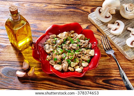 Shutterstock Tapas from Spain champinones garlic mushrooms with potatoes and sausage
