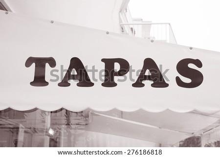 Tapas Sign in Urban Setting