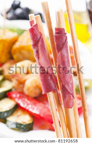 Tapas with grissini and vegetable - stock photo