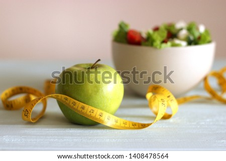 tape and lettuce on a light background. Slimming, diet, healthy food.  #1408478564
