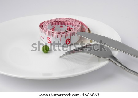 Tape meassuring and pea on a plate diet
