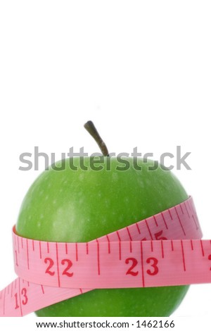 tape measure and apple, eating healthy