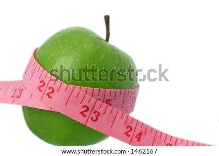 tape measure and apple, eating healthy - stock photo