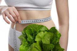tape measure and lettuce on the waist isolated