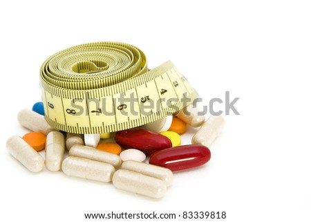 Tape measure and pills, weight loss concept