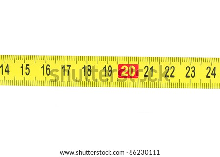 Tape measure isolated on white - stock photo
