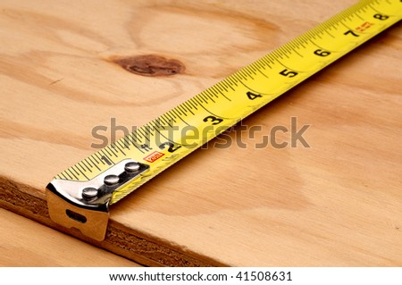 Tape measure measuring wood