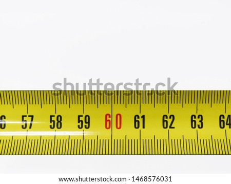 tape measure, scale. construction tool for measuring length.