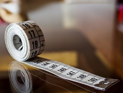 Tape measure, used by dressmakers and tailors to take measurements of the clothes to be made.