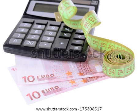 Tape measure with money and calculator isolated on white