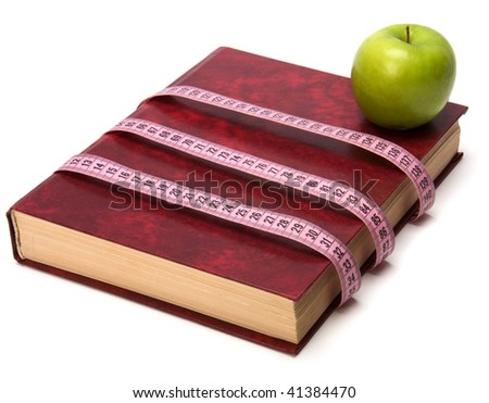 tape measure wrapped around book isolated on white background