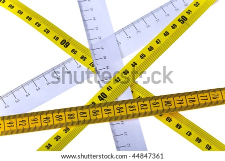 tape measures cross on white background - stock photo