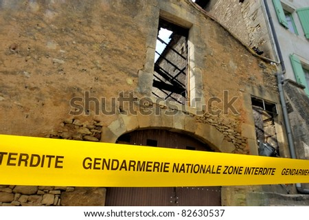 "Tape with translated text from French into English:""No admittance, National Police"". This is a crime scene in France"