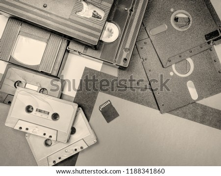 Tapes, floppy disk and memory card: old and modern technology. Sepia and hdr effect.