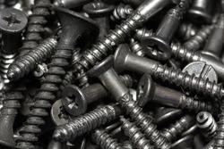 tapping screws made od steel, metal screw, iron screw, chrome screw, screws as a background, wood screw