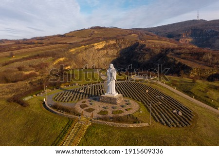 Tarcal, Hungary - Aerial view of the famous Blessing Jesus state near a mine lake. Stock fotó ©