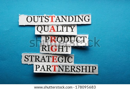 Target  acronym  in business concept, words on cut paper hard light
