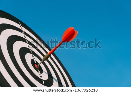 Target dart and arrow with abstract nature bokeh blur background #1369926218
