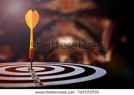 target dart with arrow over blurred Christmas background ,image for target marketing or  Christmas Holiday sale concept.