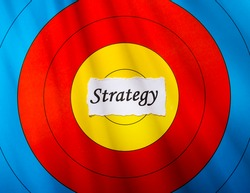 Target on strategy concept, conceptual word on color target paper.