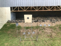 Target practice at outdoor shooting range. paper target and steel plate target