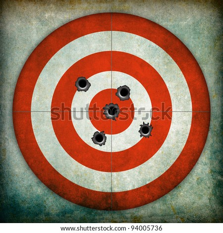 Target with bullet holes, grunge background - stock photo